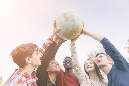 Foto de Group of Teenagers Holding World Globe Map - Imagen libre de derechos