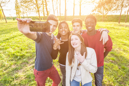 Photo for Teenage Friends Taking Selfie at Park - Royalty Free Image