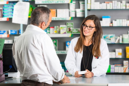 Photo for Pharmacist and Client in a Drugstore - Royalty Free Image