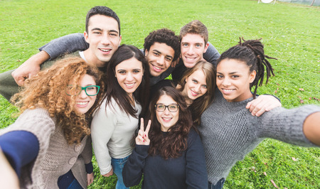 Photo pour Multiethnic Group of Friends Taking Selfie at Park - image libre de droit