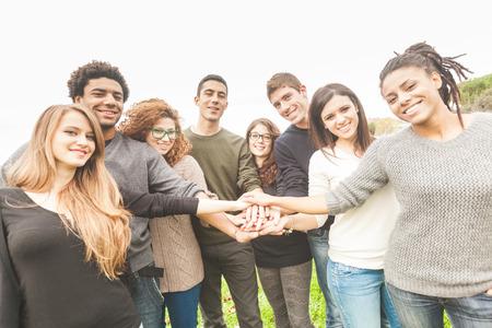 Foto de Multiracial Group of Friends with Hands in Stack, Teamwork - Imagen libre de derechos