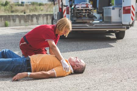 Photo pour Rescue Team Providing First Aid - image libre de droit