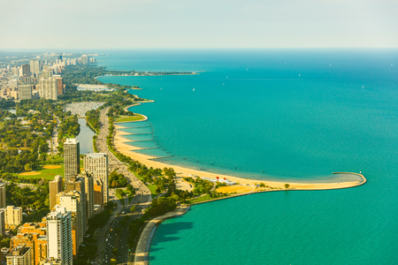 Photo pour Chicago lakeside aerial view, toned image. Vintage coloured photo of buildings and highway next to the lake Michigan. Photo from helicopter in Chicago. Summer and travel concepts - image libre de droit