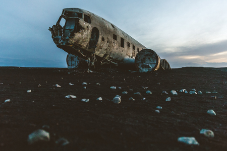 Photo for Iceland, Airplane wreck at Solheimasandur. Old and abandoned airplane, crashed on the black beach, at dusk, with nobody around. Travel and transport concepts. - Royalty Free Image