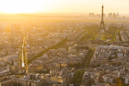 Photo pour Aerial view of Paris with Eiffel Tower on background. Panoramic view of the city at sunset, golden natural effect. Travel and architecture concepts - image libre de droit