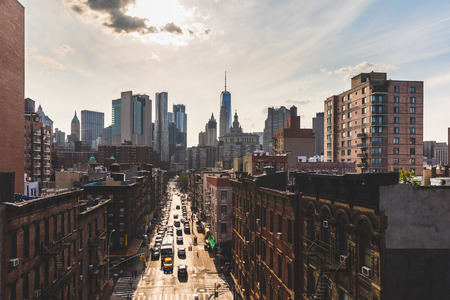 Photo pour Chinatown and downtown Manhattan in New York from Manhattan bridge. Beautiful aerial cityscape with busy street in foreground and skyscrapers on background - image libre de droit