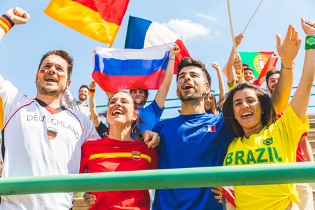 Photo for Happy supporters from different countries together at stadium. Fans from France, Germany, Spain, Brazil and other countries enjoying a match together. Sport, respect and fair play concepts - Royalty Free Image