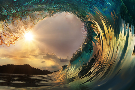 Foto de Beautiful ocean surfing wave at sunset beach - Imagen libre de derechos
