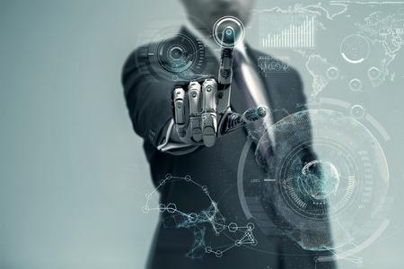 Photo pour Businessman With Artificial Robotic Hand working on virtual holographic interface. Future technology as design concept. - image libre de droit