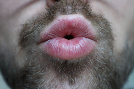 Foto de Man with facial hair giving kiss - Imagen libre de derechos