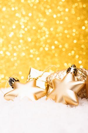 Foto de Christmas composition of Christmas tree toys on a gold background. - Imagen libre de derechos