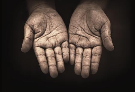 Foto de hand of child beggar in the dark - Imagen libre de derechos