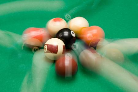 Colorful billiard balls in motion.