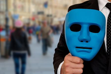 Foto de Businessman prepare to wear a mask to go out to society. Mask in hand of businessman. - Imagen libre de derechos
