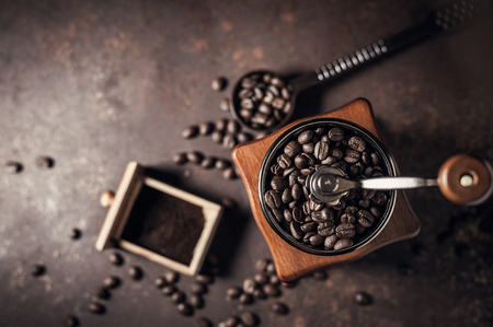 Foto für Beautiful coffee grinder and coffee bean on old kitchen table background. - Lizenzfreies Bild