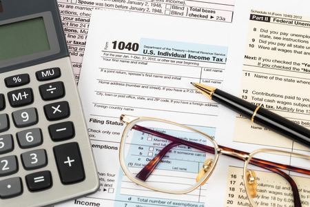 Photo pour Tax form with pen, calculator, and glasses taxation concept - image libre de droit