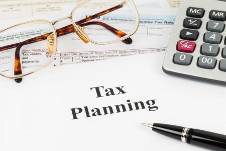 Foto de Tax planning wirh calculator and glasses taxation concept - Imagen libre de derechos