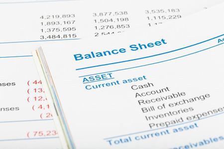 Photo pour Balance sheet in stockholder report book, document is mock-up - image libre de droit
