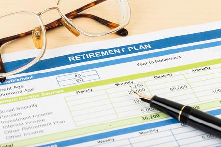 Photo pour Retirement plan with glasses and pen document is mockup - image libre de droit