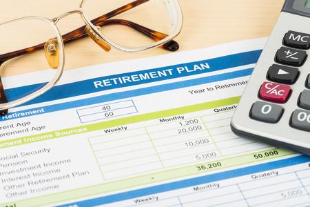 Foto de Retirement plan with glasses and calculator document is mockup - Imagen libre de derechos