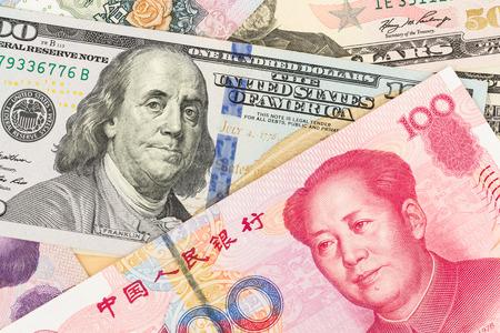 Foto de US Dollar and Chinese Yuan banknote money - Imagen libre de derechos