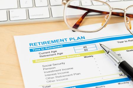 Foto de Retirement plan with keyboard and glasses, document is mock-up - Imagen libre de derechos