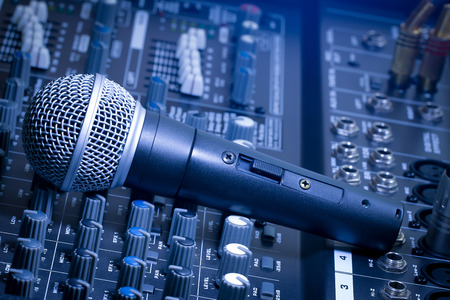 Photo for Audio mixer and microphone blue, bright images. - Royalty Free Image