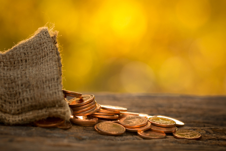 Foto de Growing money coins stack with sunset, Saving concept, wealth. - Imagen libre de derechos