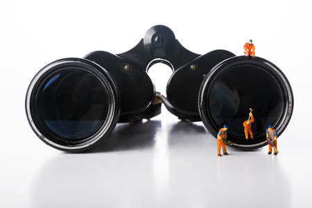 Photo for Miniature people workers with binoculars ower white background - Royalty Free Image
