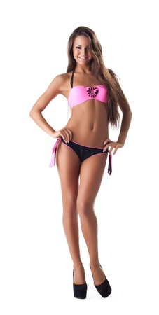 cute young girl in beach swimsuit stand isolated