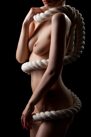 Photo pour Image of naked woman s body with rope, isolated on black - image libre de droit