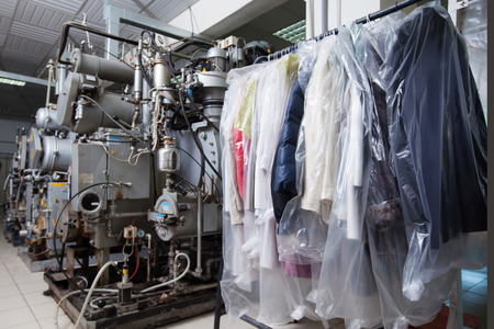 Foto de Image of clean packed clothes hanging in dry cleaning - Imagen libre de derechos