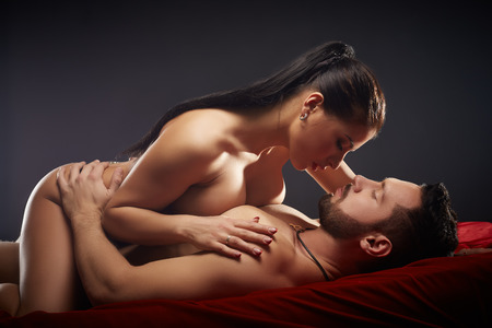 Foto de Studio photo of passionate couple having sex, close-up - Imagen libre de derechos
