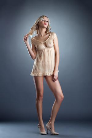 Photo pour Lingerie fashion. Hot blonde posing in erotic negligee - image libre de droit