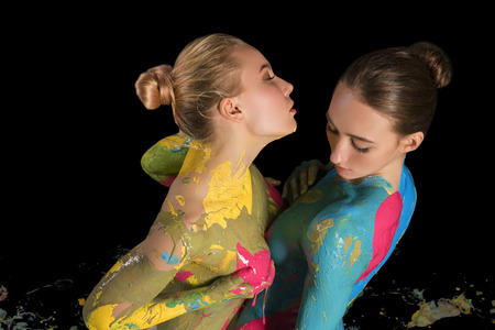 Photo for Two nude girls with colorful bodyart cropped shot - Royalty Free Image