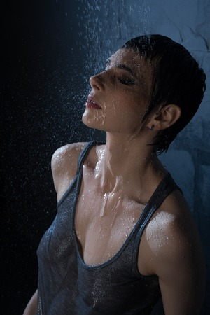 Foto de Sexy brunette in wet t-shirt high angle view - Imagen libre de derechos