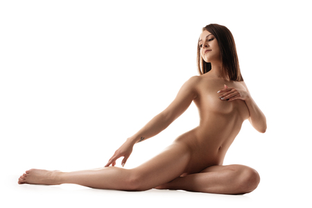 Photo pour Tanned brunette in the nude isolated shot - image libre de droit