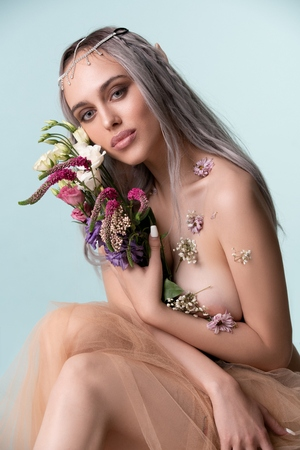 Photo for Gorgeous sexy girl-elf with flowers portrait - Royalty Free Image