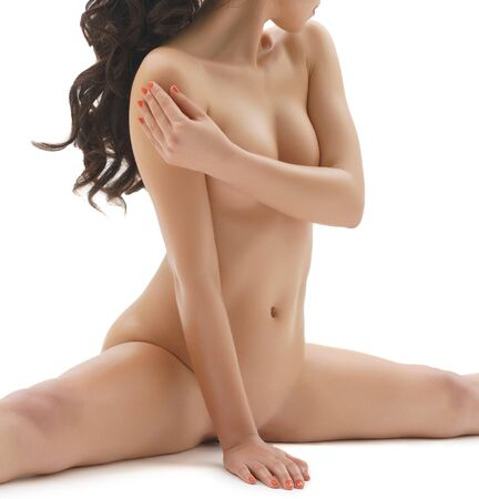 Photo for Pretty longhaired brunette shot naked in studio - Royalty Free Image