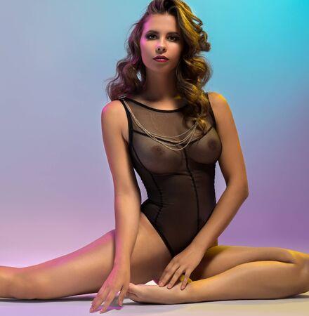Foto de Erotica. Graceful woman dressed in sexy bodysuit - Imagen libre de derechos