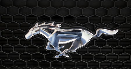 Foto de CRACOW, POLAND - MAY 20, 2017: Ford Mustang metallic logo closeup on Ford Mustang  car displayed at  MOTO SHOW in Cracow Poland. Exhibitors present  most interesting aspects of the automotive industry - Imagen libre de derechos