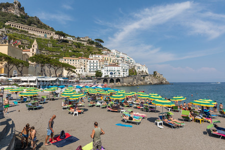 Foto de Amalfi, Italy - June 16, 2017: People are resting on a sunny day at the beach in Amalfi on Amalfi Coast in the region Campania, Italy - Imagen libre de derechos