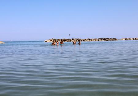 Foto de Roseto degli Abruzzi, Italy - June 21, 2017:  Beach of Roseto degli Abruzzi, Abruzzo, Italy. Roseto degli Abruzzi is also known as the 'Lido delle Rose' because of the great variety of roses and oleanders - Imagen libre de derechos