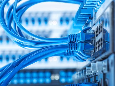Foto de Network switch and ethernet cables - Imagen libre de derechos