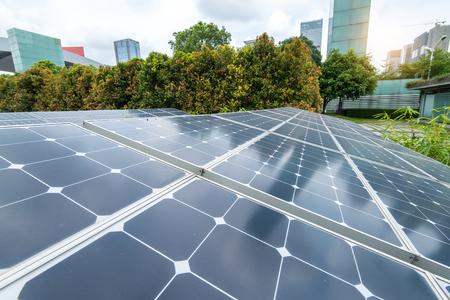 Foto de Solar Panels In The Park Of Modern City - Imagen libre de derechos