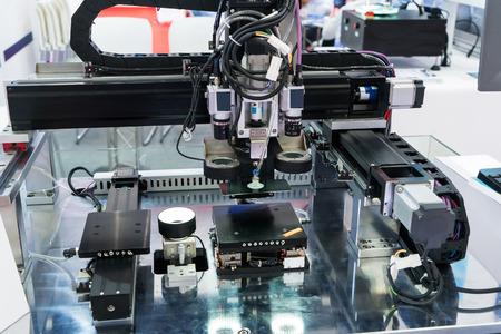Photo pour Robotic machine vision system in phone factory - image libre de droit