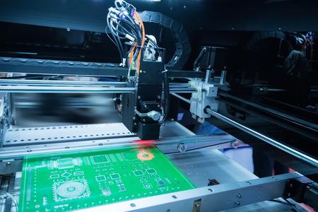 Photo pour PCB Processing on CNC machine,Production of electronic components at high-tech factory - image libre de droit