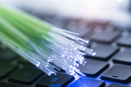 Foto de network cables and fiber optic closeup with keyboard background - Imagen libre de derechos