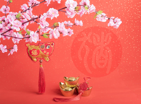 Photo pour Tradition Chinese cloth doll pig,2019 is year of the pig,Chinese characters translation: pig.chinese wording on pig mean good bless - image libre de droit