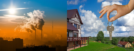 the juxtaposition of the city with the smoking factory chimneys and clean rural view with green lawn